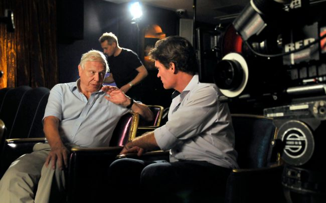 Craig Leeson sits with with Sir David Attenborough