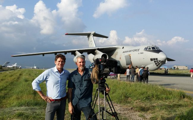 Craig Leeson with camera and a man in front of Indian Air Force plane
