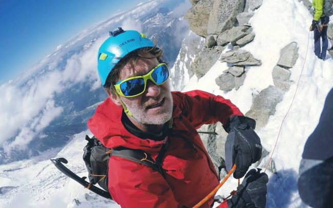 Adventurer Craig Leeson climbing the French Alps