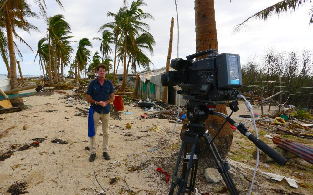 Journalist Craig Leeson reporting on a beach after storm.